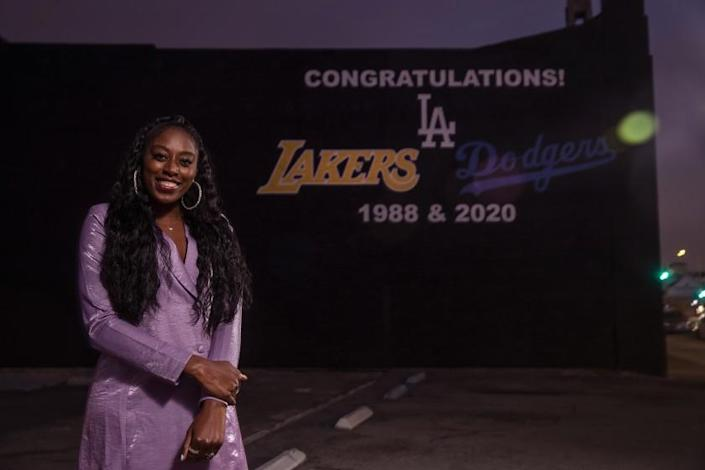 LOS ANGELES, CA - DECEMBER 10: Chiney Ogwumike, of the Los Angeles Sparks, is photographed in front of a mural on 3rd St. in Los Angeles, honoring the Los Angeles Lakers and Los Angeles Dodgers on their 1988 and 2020 championship seasons. Ogwumike opted out of playing in the WNBA this season due to medical reasons. (Mel Melcon / Los Angeles Times)