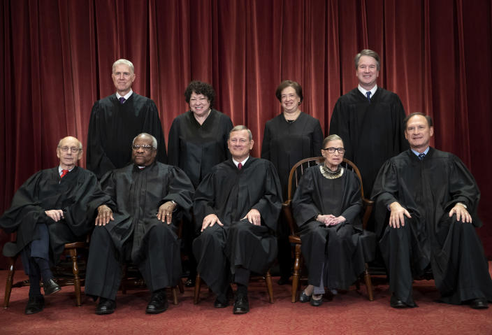 FILE - In this Nov. 30, 2018, file photo, the justices of the U.S. Supreme Court gather for a formal group portrait to include a new Associate Justice, top row, far right, at the Supreme Court Building in Washington. Seated from left: Associate Justice Stephen Breyer, Associate Justice Clarence Thomas, Chief Justice of the United States John G. Roberts, Associate Justice Ruth Bader Ginsburg and Associate Justice Samuel Alito Jr. Standing behind from left: Associate Justice Neil Gorsuch, Associate Justice Sonia Sotomayor, Associate Justice Elena Kagan and Associate Justice Brett M. Kavanaugh. (AP Photo/J. Scott Applewhite, File)