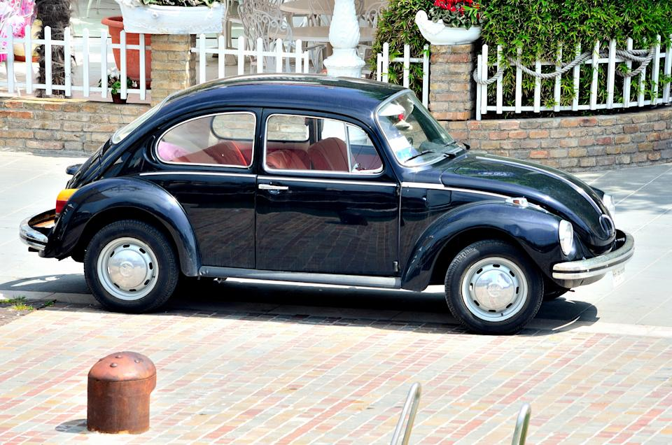 """[UNVERIFIED CONTENT] The Volkswagen Beetle, officially called the Volkswagen Type 1 (or informally the Volkswagen Bug), is an economy car produced by the German auto maker Volkswagen,from 1938 until 2003. In 1973, the VW 1303 introduced a curved windscreen, pushed forward and away from the passengers, allowing a redesigned, padded dashboard to replace the pre-1973 vertical dash. A two-speed heater fan, higher rear mudguards, and larger tail lights were added. The changes to the heater/windshield wiper housing and curved windshield resulted in slight redesign of the front hood, making the 1971 and 1972 Super Beetle hoods unique. In late 1973, the well-equipped """"1303/Big"""" special edition was introduced as customers were looking for less spartan cars. These have 15-inch wheels, metallic paintwork, a more luxurious interior, a heated rear windshield, and some other comforts."""