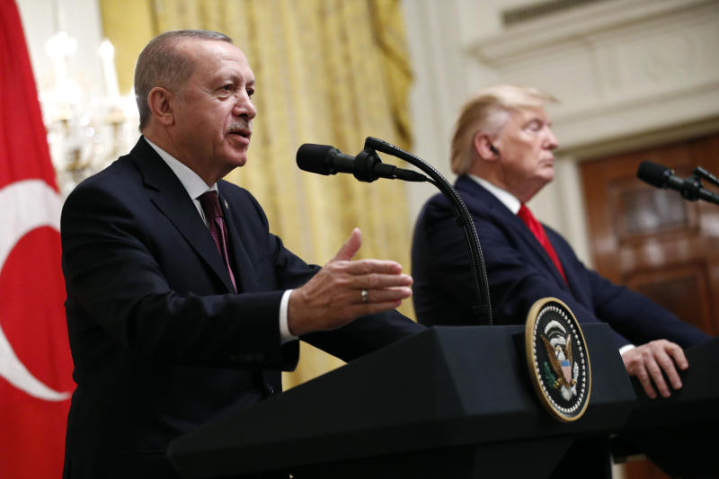 Turkish President Recep Tayyip Erdogan speaks at a news conference alongside President Donald Trump in the East Room of the White House, Wednesday, Nov. 13, 2019, in Washington. (AP Photo/Patrick Semansky)