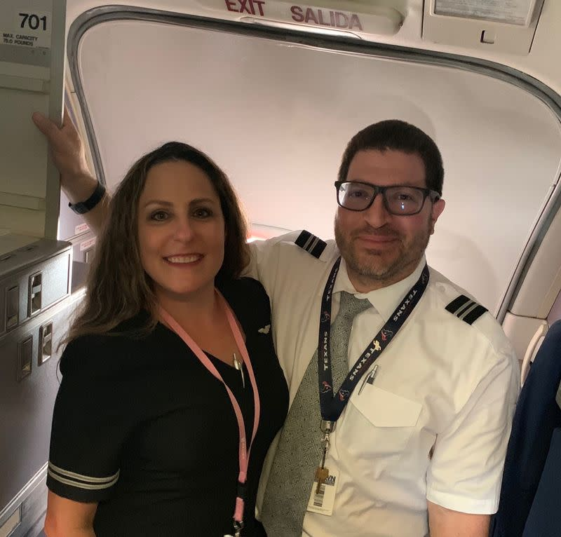 Jessica and Rene Trujillo pose after a United Airlines flight from San Francisco in Houston