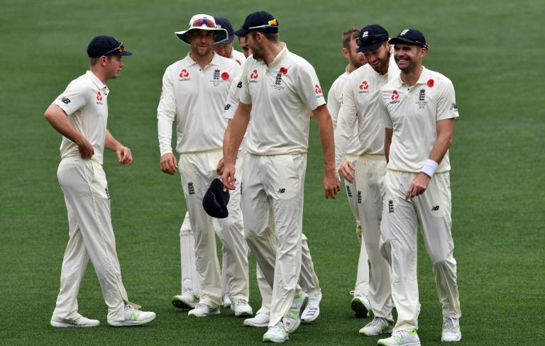 England's players walk off the field following their victory against Cricket Australia XI on the last day of a four-day Ashes tour match, at Adelaide Oval, on November 11, 2017