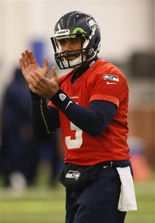 Seattle Seahawks quarterback Russell Wilson claps during their NFL Super Bowl XLVIII football practice in East Rutherford, New Jersey, January 30, 2014. REUTERS/Shannon Stapleton