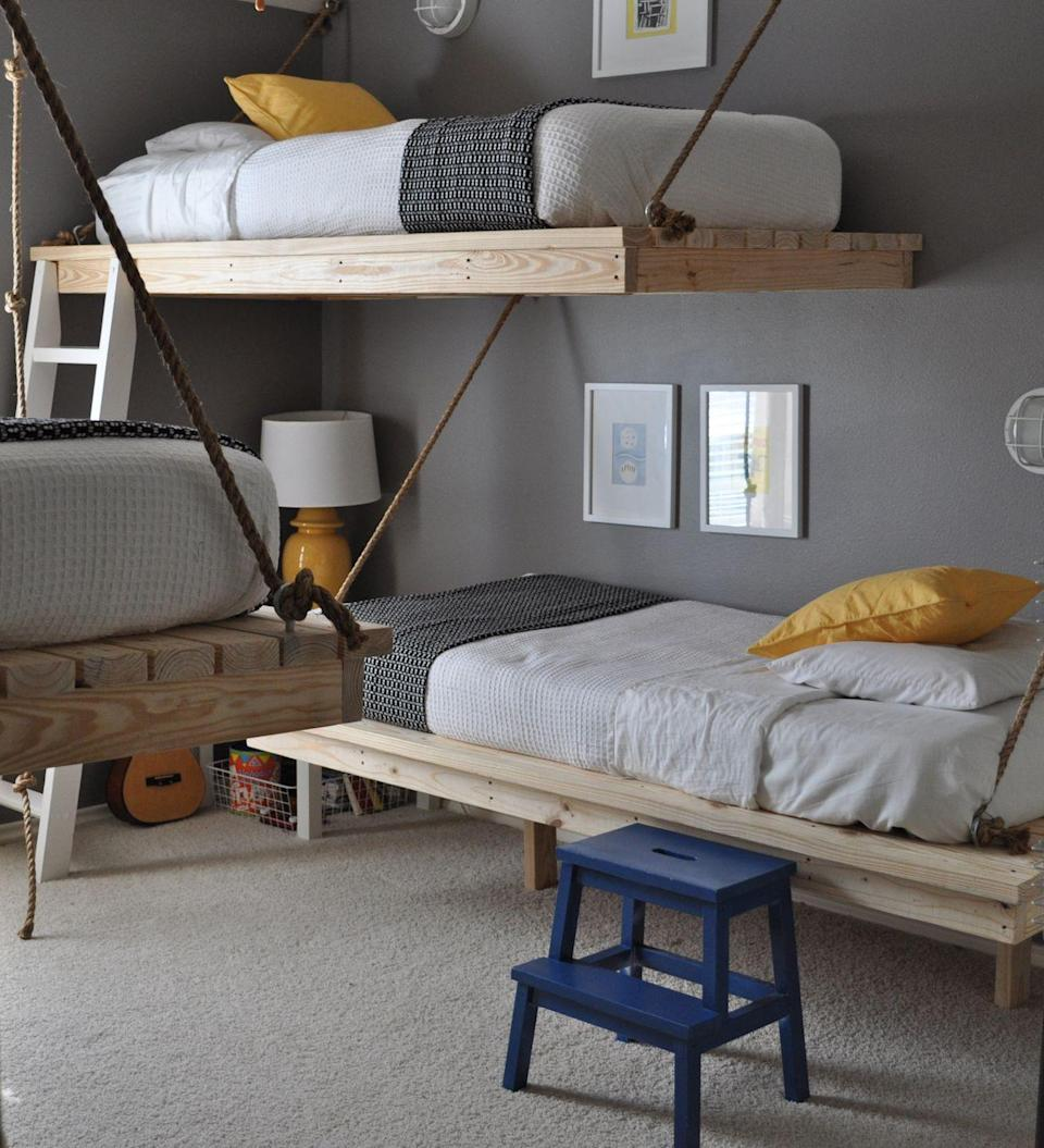"""<p>Here's how you fit three teens in a room and have it actually seem fun. You might need a contractor's help, but it'll be worth if for how awed their friends will be when they come over. See more at <a href=""""https://thebumpercrop.wordpress.com/2010/10/28/three-boys-one-room/"""" rel=""""nofollow noopener"""" target=""""_blank"""" data-ylk=""""slk:The Bumper Crop"""" class=""""link rapid-noclick-resp"""">The Bumper Crop</a>.</p>"""