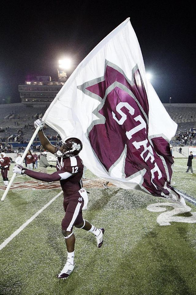 Mississippi State wide receiver Robert Johnson celebrates after beating Rice in the Liberty Bowl NCAA college football game Tuesday, Dec. 31, 2013, in Memphis, Tenn. Mississippi State won 44-7. (AP Photo/Mark Humphrey)