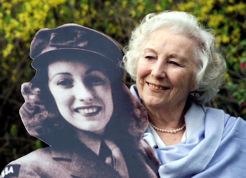 File photo dated 23/03/20 of Dame Vera Lynn in the garden of the Savoy Hotel, after she was named personality of the century in a nationwide poll. Queen Elizabeth II gave a televised message to the nation during the coronavirus outbreak.