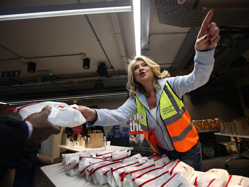 British Red Cross Celebrity Ambassador Amanda Redman taking part in an emergency simulation with an extreme snow scenario by the British Red Cross UK crisis response team, at Hoxton Square, London.