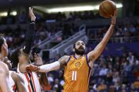Phoenix Suns guard Ricky Rubio (11) drives past Portland Trail Blazers guard Gary Trent Jr., left, to score during the second half of an NBA basketball game Friday, March 6, 2020, in Phoenix. (AP Photo/Ross D. Franklin)