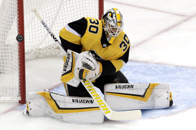 Pittsburgh Penguins goaltender Matt Murray blocks a shot during the first period of an NHL hockey game against the Tampa Bay Lightning in Pittsburgh, Wednesday, Jan. 30, 2019. (AP Photo/Gene J. Puskar)