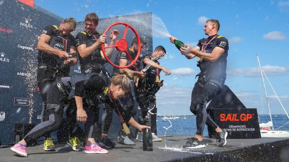 The Australian team celebrates in traditional yachting fashion after winning the Danish series. - Credit: Courtesy SailGP