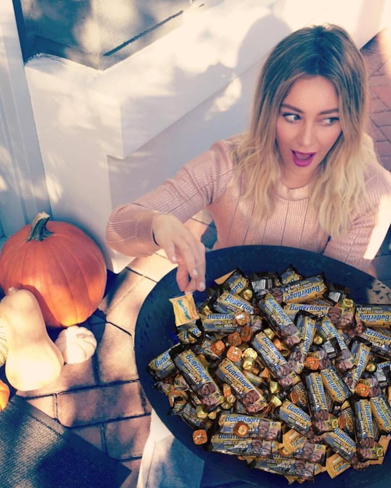 """<p>Halloween is still a couple of weeks away, but the <i>Younger</i> star's sweet tooth has already kicked into high gear: """"Shhh…Don't tell anyone, but I'm dipping into my Halloween candy early!"""" (Photo: <a href=""""https://www.instagram.com/p/BLZE1nTBt-2/"""">Instagram</a>) </p>"""