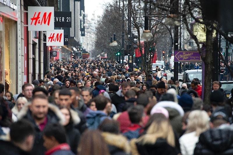 Scenes like this image of London shoppers taken on December 27, 2018 could become more common in countries where the population is booming - although overall global growth is slowing