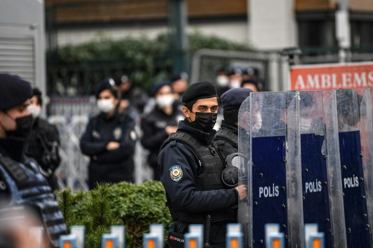 Turkish anti riot police officers stand guard at the main gate of the Bogazici university on in Istanbul during a protest against the appointment of the new rector by the Turkish president.