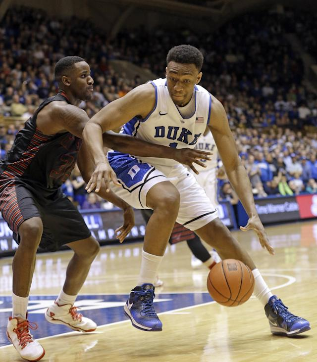Duke's Jabari Parker, right, is guarded by Gardner-Webb's Jerome Hill (35) during the second half of an NCAA college basketball game in Durham, N.C., Monday, Dec. 16, 2013. Duke won 85-66. (AP Photo/Gerry Broome)