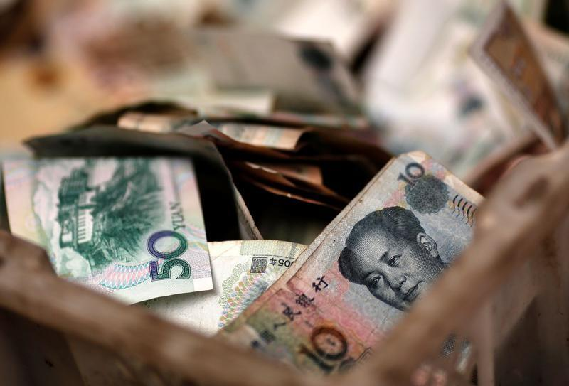 FILE PHOTO - Chinese banknotes are seen at a vendor's cash box at a market in Beijing