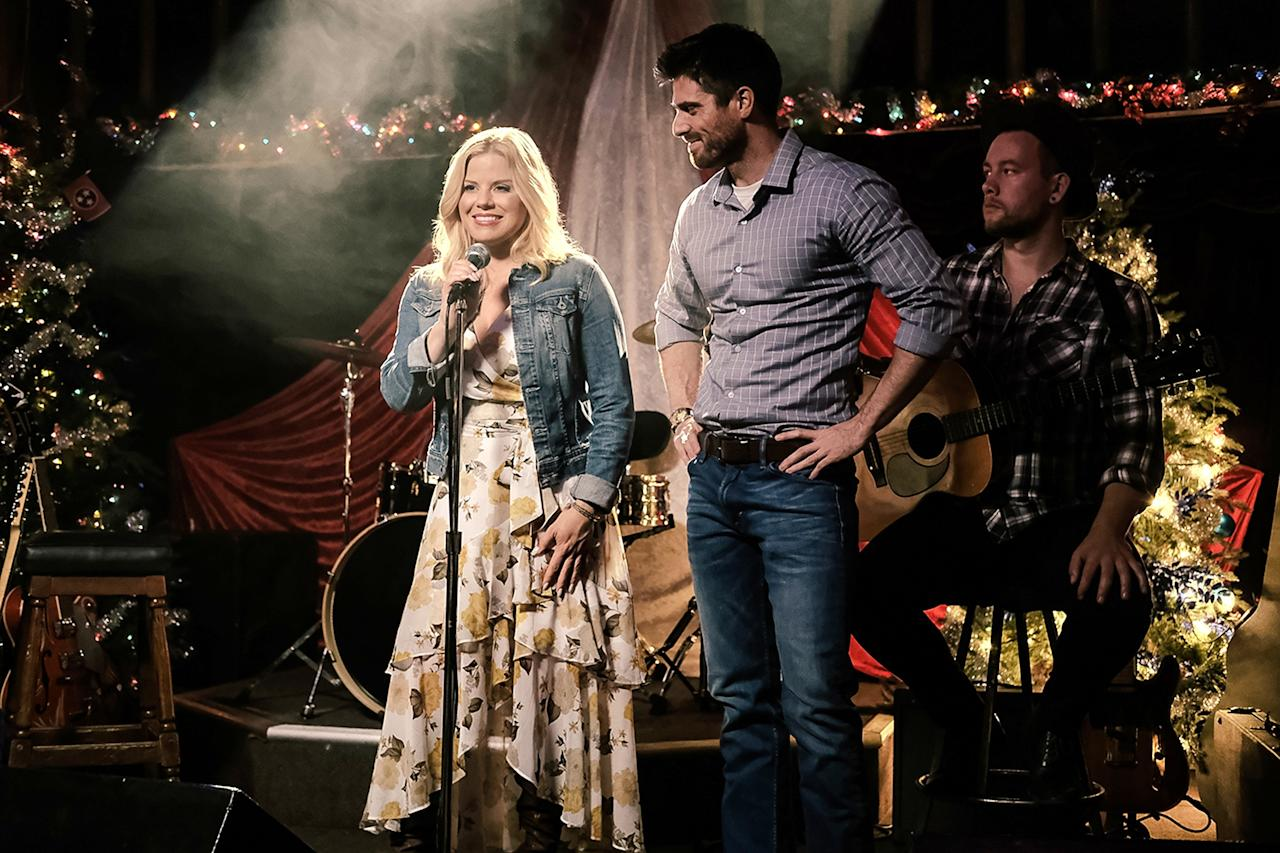 """<strong>Stars:</strong> Megan Hilty, Marcus Rosner <strong>Contains:</strong> Country-cooked homecoming, stranding by bad weather, romance with snowplow driver <strong>Official description:</strong> """"Country music star Laney Blu (Hilty) hasn't been back to her Tennessee hometown in years. It wasn't the kindest place to grow up, so when her career skyrocketed at 17 she was happy to leave it behind. Though she's set to headline a Christmas concert in NYC, Laney decides to make a quick pit stop to see her family. When a freak snowstorm hits, she finds herself stranded in the town, and is roped into taking part in a local Christmas concert. As Laney spends more time in her hometown, it becomes less and less like she remembered it. She begins to fall in the love with the people, place and just<em>maybe,</em>a handsome snowplow driver named Robbie (Rosner). When the storm lets up, will Laney head off to NYC or will home be where her heart is?"""""""