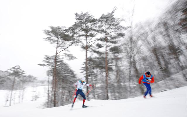 Biathlon - Pyeongchang 2018 Winter Paralympics - Men's 15km - Standing - Alpensia Biathlon Centre - Pyeongchang, South Korea - March 16, 2018 - Nils-Erik Ulset of Norway competes as his coach shouts instructions. REUTERS/Carl Recine
