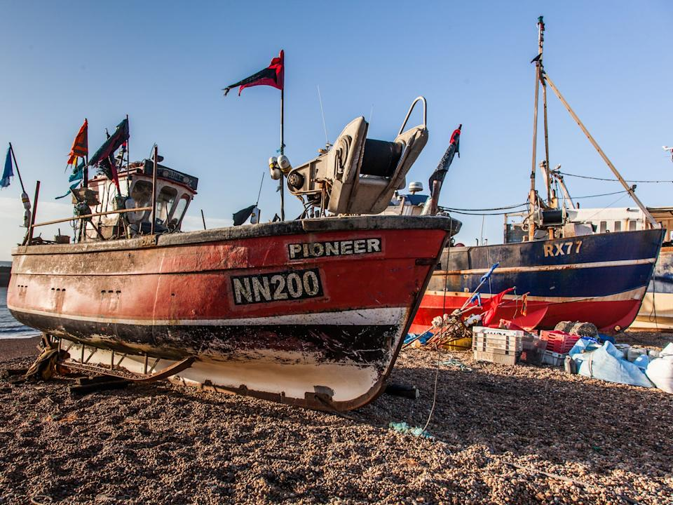 Fishing boats out of the water in Hastings - the town is home to Europe's largest beach-launched fishing fleet: Getty