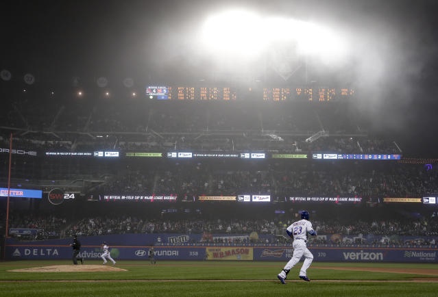 New York Mets' Adrian Gonzalez (23) makes his way up the first base line on a fly-out to left field as a blanket of fog hangs over CitiField during the sixth inning of a baseball game against the Arizona Diamondbacks, Saturday, May 19, 2018, in New York. (AP Photo/Julie Jacobson)