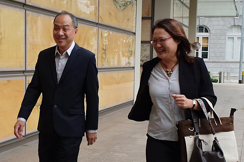 Former Workers' Party chief Low Thia Khiang and WP chairperson Sylvia Lim seen outside the Supreme Court on Tuesday (16 October). (PHOTO: Wan Ting Koh / Yahoo News Singapore)