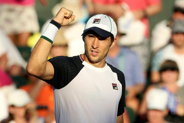 Dusan Lajovic of Serbia celrbsates match point against Vasek Pospisil of Canada during their BNP Paribas Open third round match, at the Indian Wells Tennis Garden in California, on March 13, 2017