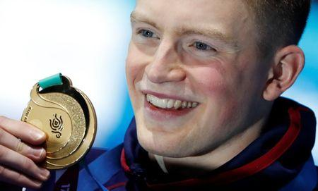 Swimming – 17th FINA World Aquatics Championships – Men's 50m Breaststroke awarding ceremony – Budapest, Hungary – July 26, 2017 – Adam Peaty (gold) of Britain poses with the medal. REUTERS/Bernadett Szabo