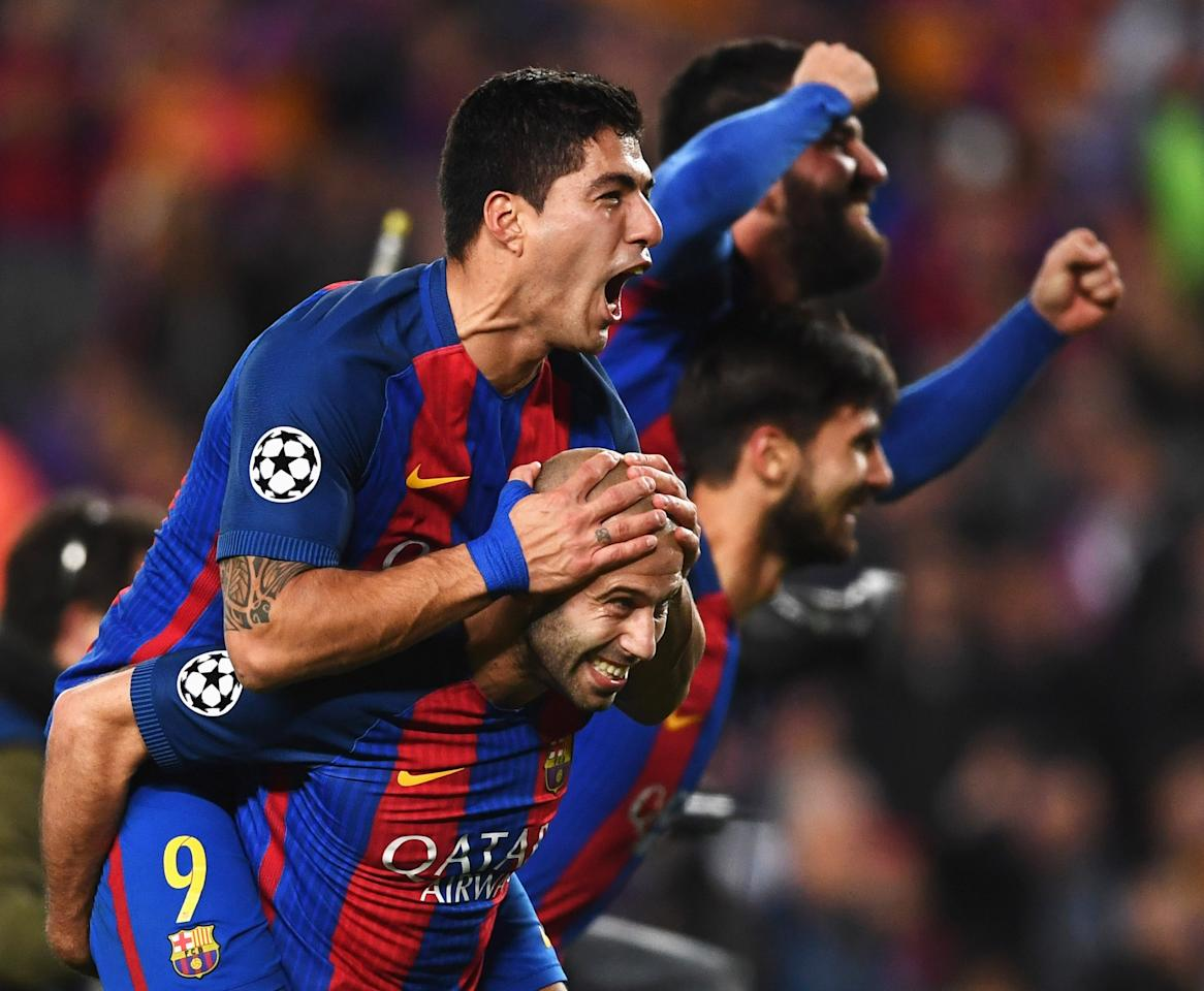 <p>Luis Suarez (L) and Javier Mascherano of Barcelona celebrate victory after the UEFA Champions League Round of 16 second leg match between FC Barcelona and Paris Saint-Germain at Camp Nou on March 8, 2017 in Barcelona, Spain. Barcelona won by 6 goals to one to win 6-5 on aggregate. (Photo by Laurence Griffiths/Getty Images) </p>