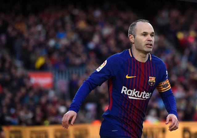 Barcelona's midfielder Andres Iniesta looks on during the Spanish league football match against Getafe February 11, 2018 (AFP Photo/Josep LAGO)