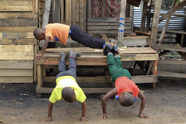Children use a deserted market stall into an exercise bench as business came to a standstill on the third day of protests over the hike in fuel prices in Harare, Zimbabwe, Wednesday, Jan. 16, 2019. Streets are deserted in Harare on Wednesday as a general strike continues for a third day to protest the government's decision to more than double the price of fuel. (AP Photo/Tsvangirayi Mukwazhi)