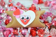 """<p>Save your paper rolls and transform them into sweet little holders for Valentine's Day candies or other treats. Let kids customize however they like with foam hearts, googly eyes, and feathers (with a grownup helping out with the hot glue when needed).</p><p><em><a href=""""https://threelittleferns.com/2018/01/diy-valentines-treat-craft.html"""" rel=""""nofollow noopener"""" target=""""_blank"""" data-ylk=""""slk:Get the how-to at Three Little Ferns»"""" class=""""link rapid-noclick-resp"""">Get the how-to at Three Little Ferns»</a></em><br></p>"""