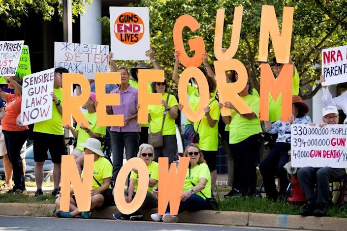 Supporters of gun control reform protest against the National Rifle Association at the NRA headquarters in Fairfax, Virginia on Wednesday. There has been a renewed call for gun control reform legislation in the United States following the mass shooting that killed 22 people in El Paso, Texas; and the mass shooting the following day in Dayon, Ohio, that resulted in ten deaths.