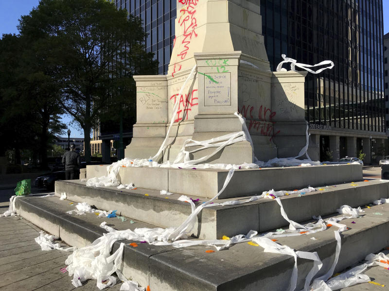 Graffiti, toilet papers and eggs are seen on and around the Confederate Monument in downtown Norfolk, Va., on Sunday, May 31, 2020. Protesters sprayed paint on the monument on Saturday night protest on May 30, 2020. (The N. Pham/The Virginian-Pilot via AP)