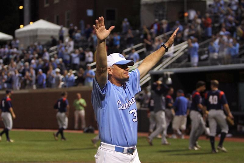 North Carolina head baseball coach Mike Fox celebrates his team's 12-11 win over Florida Atlantic in 13 innings during an NCAA college regional championship baseball game in Chapel Hill, N.C., Monday, June 3, 2013. (AP Photo/Ted Richardson)