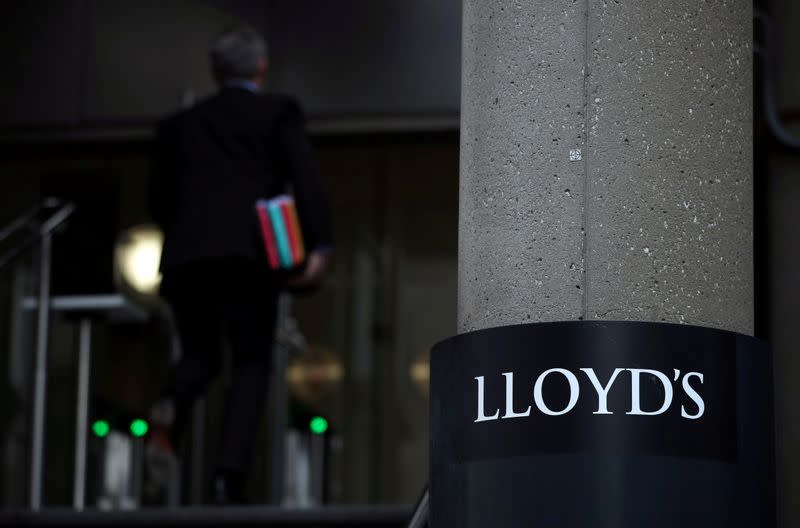 FILE PHOTO: Man enters the Lloyd's of London building in the City of London financial district