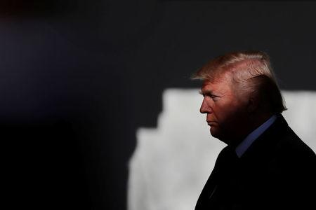 U.S. President Donald Trump prepares to address the annual March for Life rally, taking place on the National Mall, from the White House Rose Garden in Washington, U.S., January 19, 2018. REUTERS/Carlos Barria