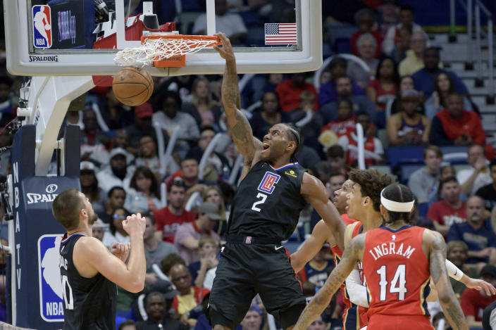 Los Angeles Clippers forward Kawhi Leonard (2) dunks against New Orleans Pelicans center Jaxson Hayes (10) in the second half an NBA basketball game in New Orleans, Saturday, Jan. 18, 2020. (AP Photo/Matthew Hinton)