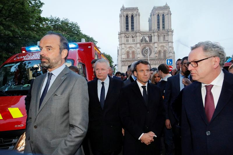 French President Emmanuel Macron (3rd left) rushed to the scene of the fire at Notre-Dame as flames engulfed its roof