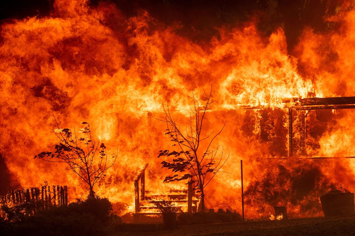 Flames consume a home as the River Fire tears though Lakeport.