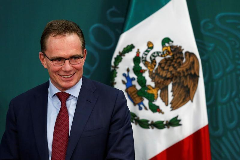 Andrew Mackenzie, CEO of BHP Billiton, stands next to the Mexican flag during the first-deep water contract ceremony between Pemex and BHP Billiton, in Mexico City, Mexico
