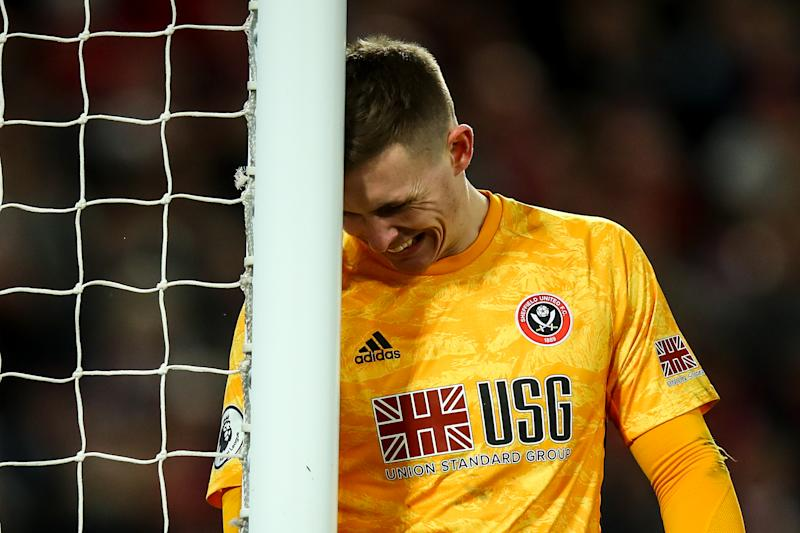 LIVERPOOL, ENGLAND - JANUARY 02: Dean Henderson of Sheffield United reacts after conceding the second goal during the Premier League match between Liverpool FC and Sheffield United at Anfield on January 2, 2020 in Liverpool, United Kingdom. (Photo by Robbie Jay Barratt - AMA/Getty Images)
