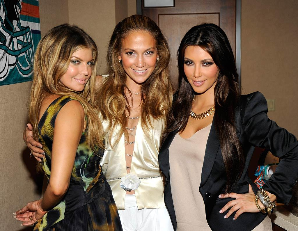 """Miami Dolphins minority owners Fergie and Jennifer Lopez joined reality starlet Kim Kardashian at their football team's home season opener against the New York Jets at Sun Life Stadium in Miami on Sunday. Kevin Mazur/<a href=""""http://www.wireimage.com"""" target=""""new"""">WireImage.com</a> - September 26, 2010"""