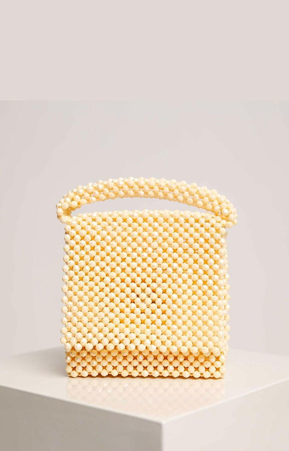 <p>Thia <span>Lisa Folawiyo Beaded Top Handle Bag</span> ($250) will look so sweet with a dress.</p>