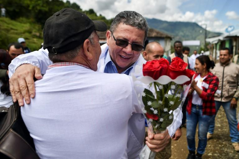 Pablo Catatumbo (R), a former leader of Colombia's largest guerrilla group, is now a candidate for the senate, seen here stumping for votes in a mountainous area where he once fought