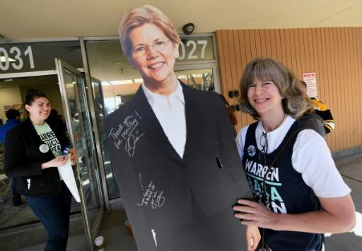 Democratic presidential hopeful Senator Elizabeth Warren, whose cardboard cutout proved a hit at her Las Vegas field office, claimed a fundraising bump after her standout debate performance ahead of Nevada's caucuses