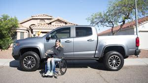 TrueCar's DrivenToDrive 2020 Recipient, Karah Behrend, next to her brand-new 2020 Chevrolet Colorado ZR2.