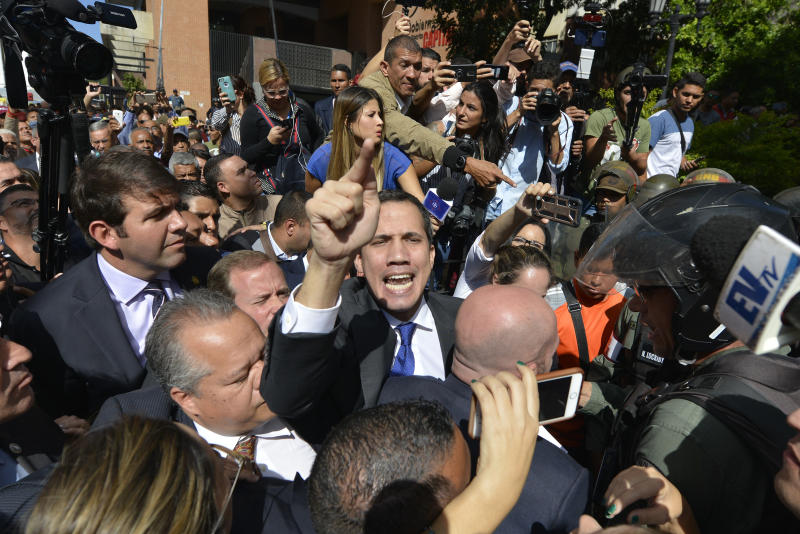 Opposition leader Juan Guaidó argues for National Guards to let him and all opposition lawmakers into the National Assembly, outside the legislature in Caracas, Venezuela, Tuesday, Jan. 7, 2020. Venezuela's opposition is facing its biggest test yet after government-backed lawmakers announced they were taking control of what Guaidó supporters have described as the nation's last democratic institution. (AP Photo/Matias Delacroix)