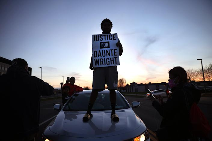 <p>Protest near the Brooklyn Center police station on 16 April  in Minnesota in the wake of the fatal shooting of 20-year-old Daunte Wright by Brooklyn Center police officer </p> (Getty Images)