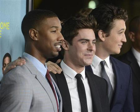 "From L-R: Cast members Michael B. Jordan, Zac Efron and Miles Teller attend the premiere of the film ""That Awkward Moment"" in Los Angeles January 27, 2014. REUTERS/Phil McCarten"