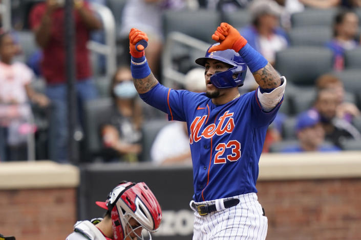 New York Mets' Javier Baez gestures at home plate after his two-run home run that also scored Michael Conforto during the fourth inning of a baseball game against the Washington Nationals, Sunday, Aug. 29, 2021, in New York. (AP Photo/Corey Sipkin)