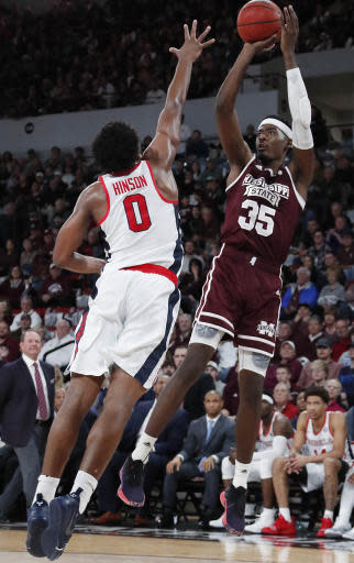 Mississippi State forward Aric Holman (35) shoots over Mississippi guard Blake Hinson (0) in the first half of an NCAA college basketball game, Saturday, Jan. 12, 2019 in Starkville, Miss. (AP Photo/Rogelio V. Solis)